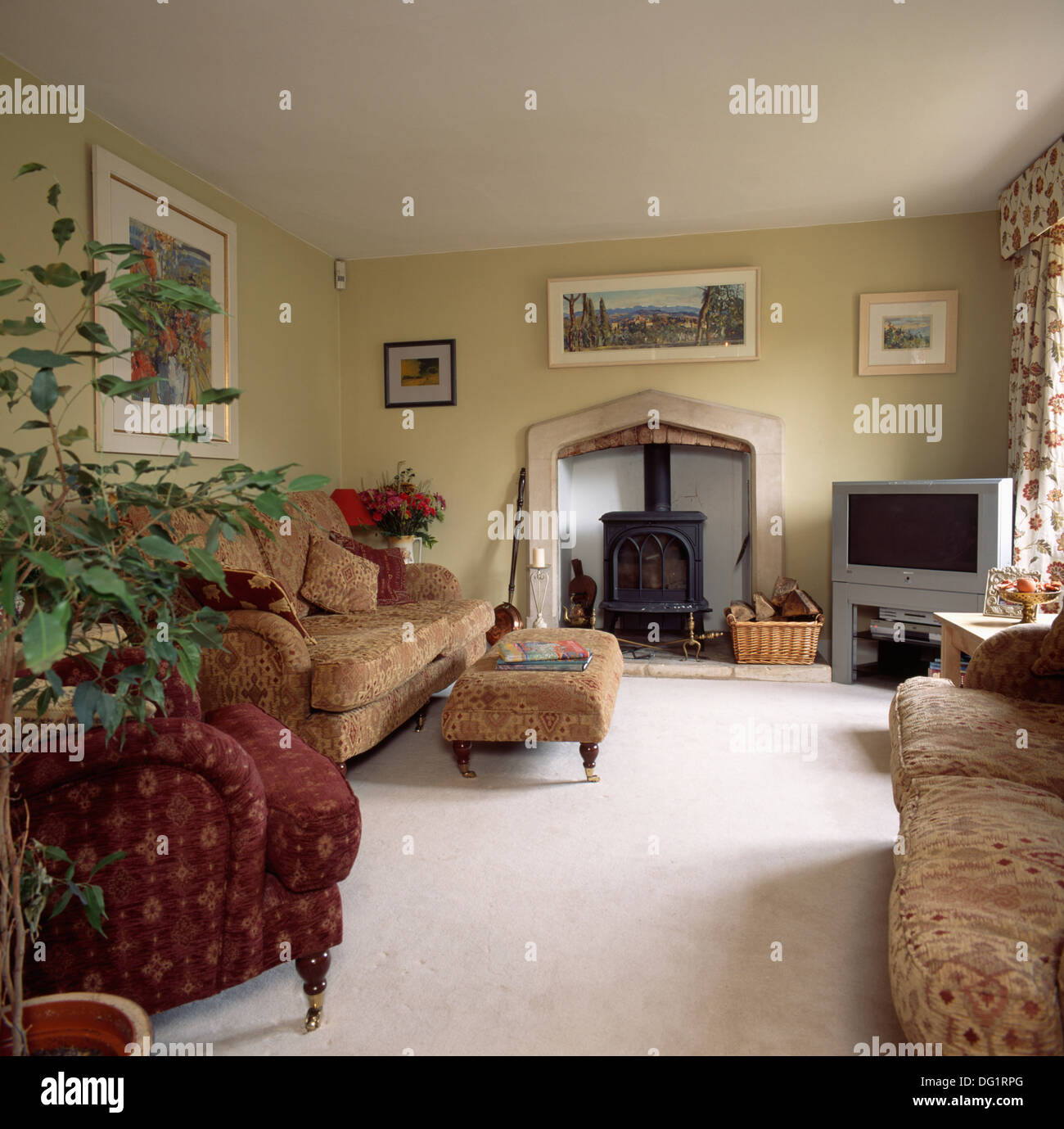 Cream carpet and neutral patterned sofas in country living room ...