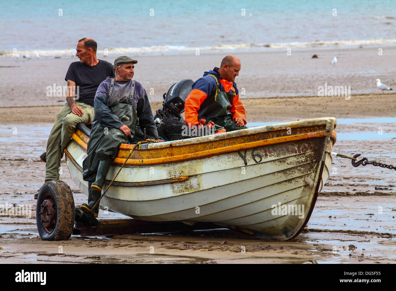 Filey fishing coble being towed back to the coble landing Stock Photo, Royalty Free Image ...