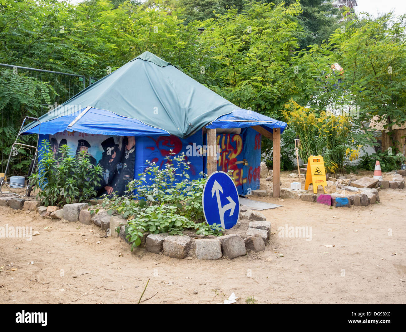 Squatters set up informal tented community using recycled materials to build homes and gardens - Berlin & Squatters set up informal tented community using recycled ...