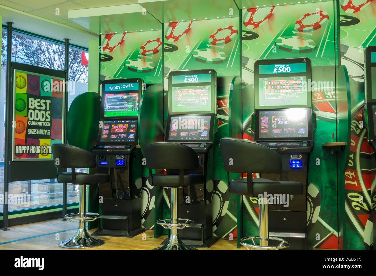 Gaming machines in paddy power betting office england uk stock image