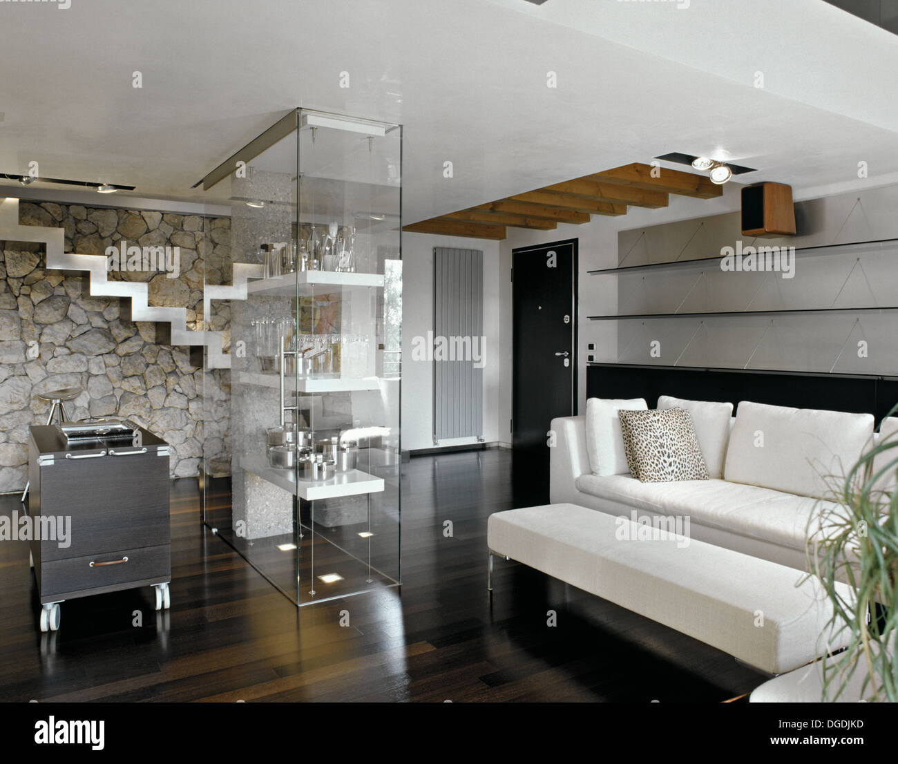 Modern Living Room With Fabric Sofa Glass Cabinet And Staircase
