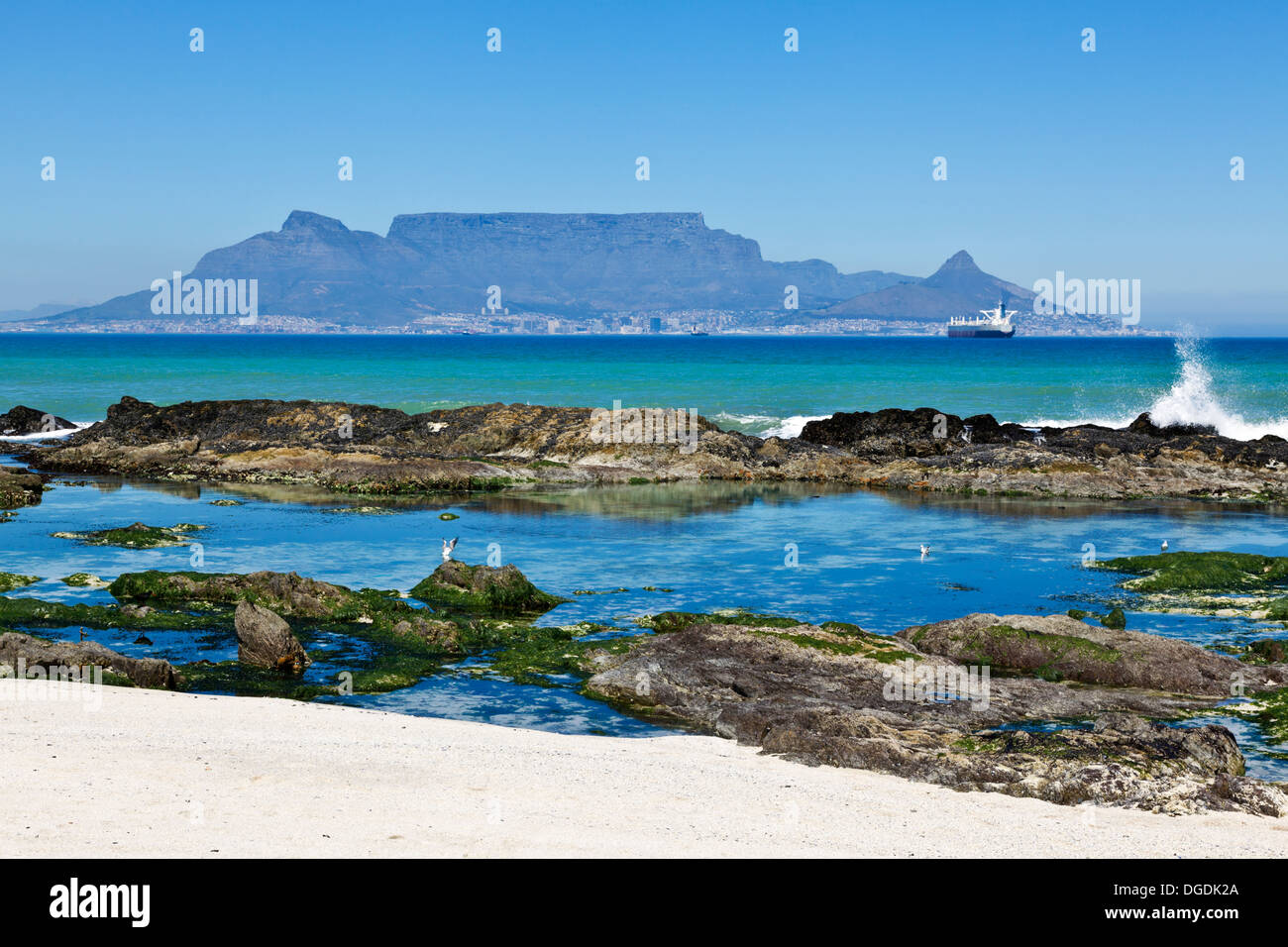 A rocky beach tidal pool with table mountain in the - Table mountain wallpaper ...