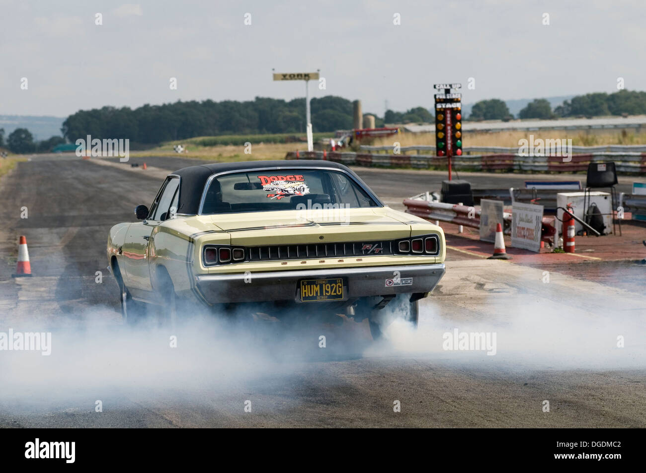Dodge Muscle Car Doing A Static Burnout In The Water Box Before A