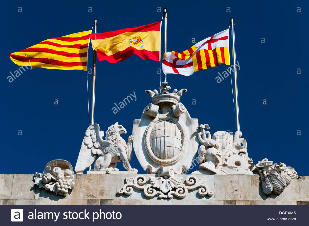 flags of catalonia spain and barcelona waving on the top of the