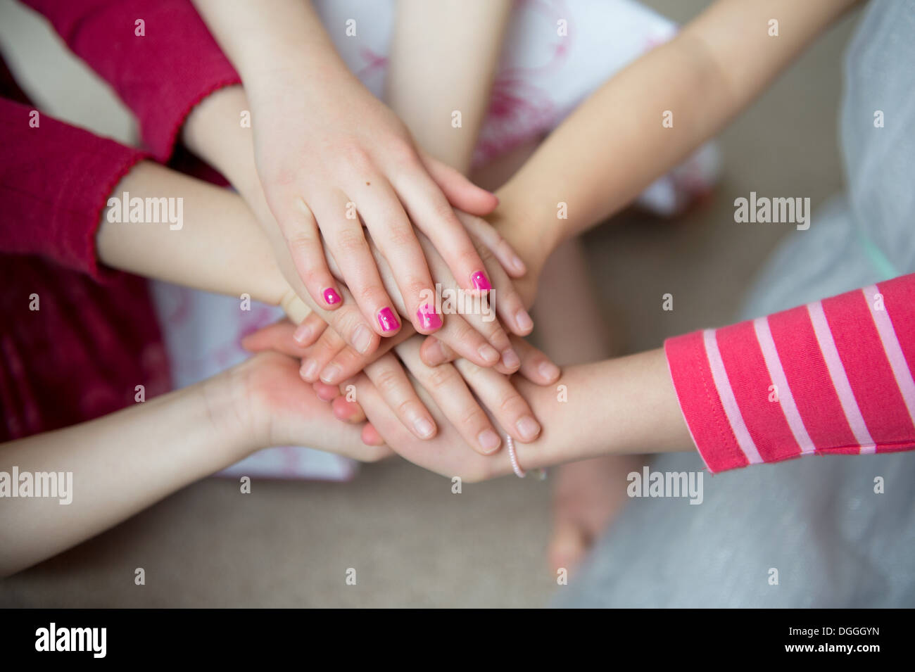 Girls putting hands together, close up Stock Photo: 61830153 - Alamy