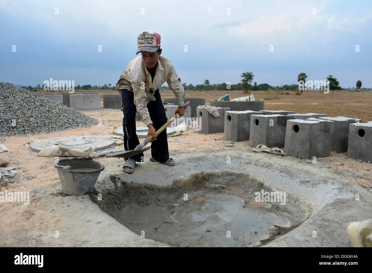 Associated Cement Companies : Young man in a local construction company mixing cement to