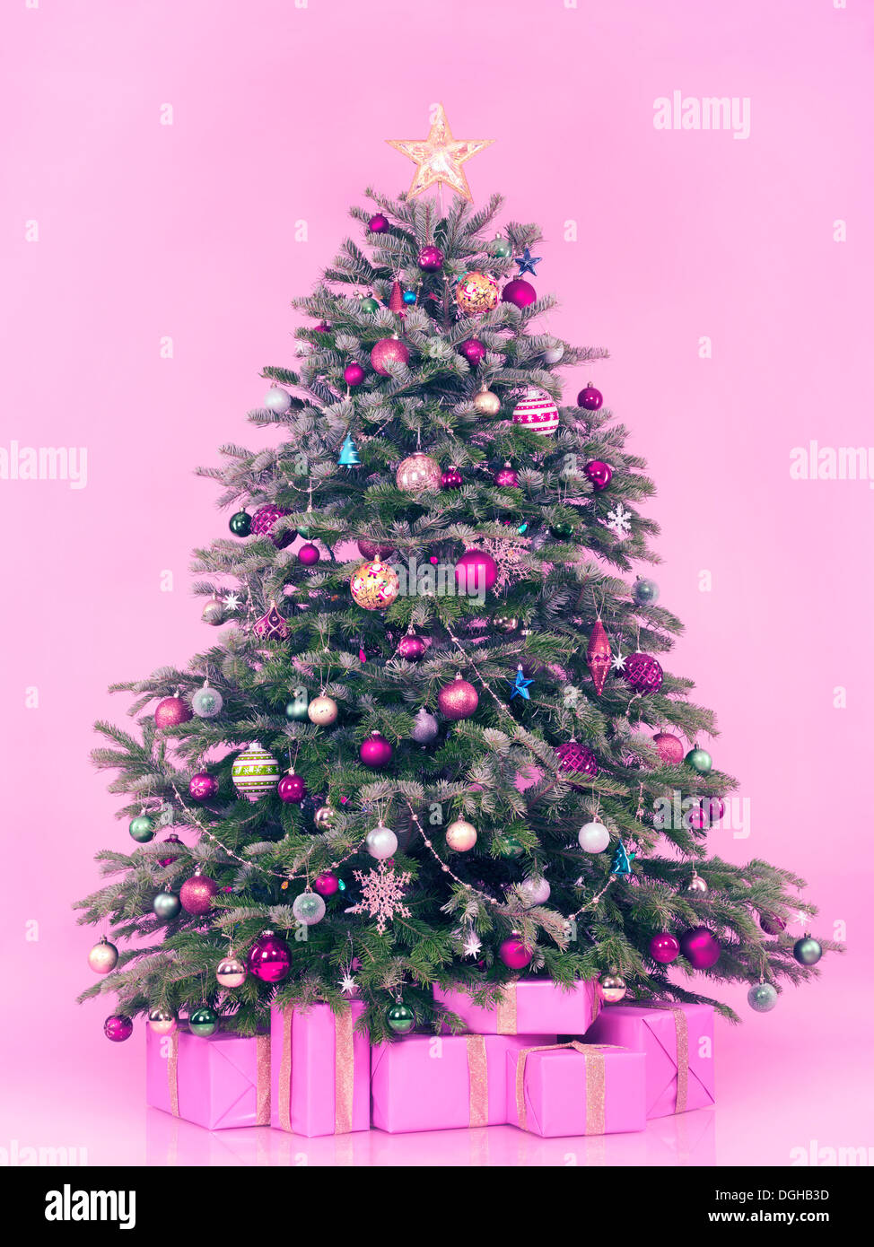 Christmas Trees Decorated Pink - Decorated christmas tree with presents and gift boxes isolated on pink background in pastel colors with