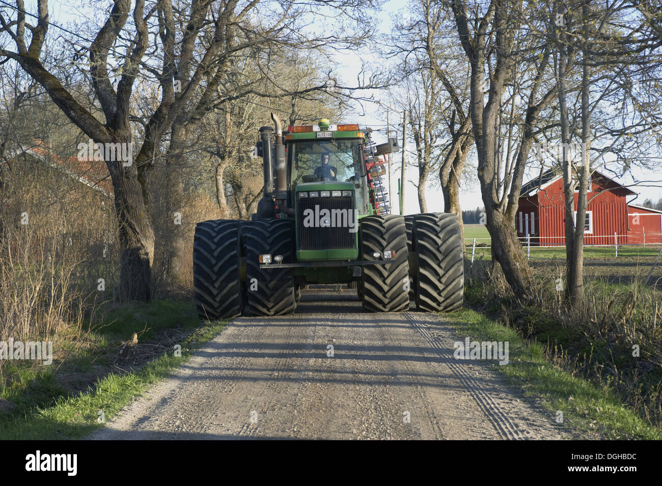 John Deere Tractor With Dual Wheels Driving Along Small Road Dghbdc