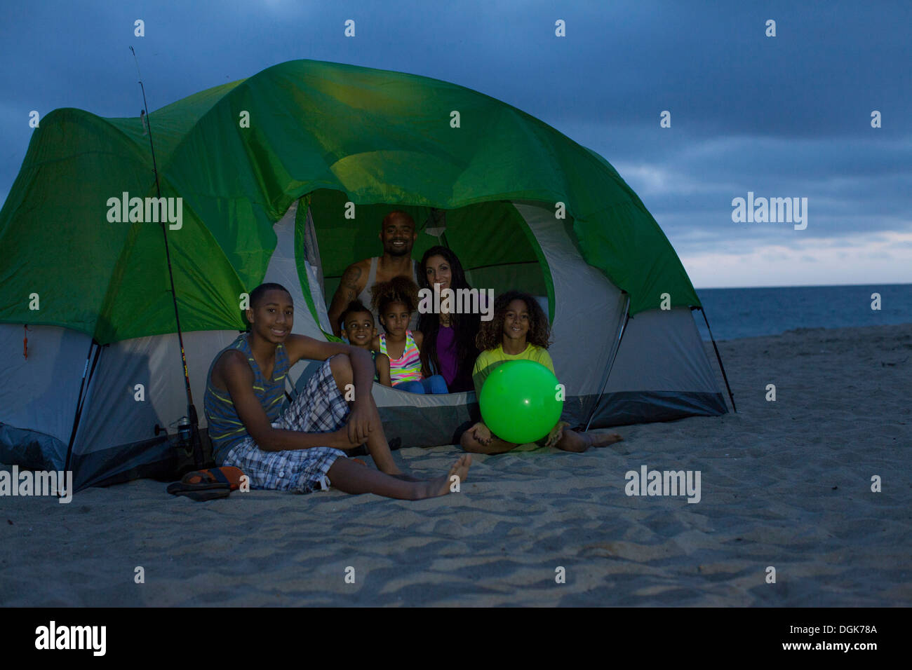Family With Four Children In Tent On Huntington Beach California Usa