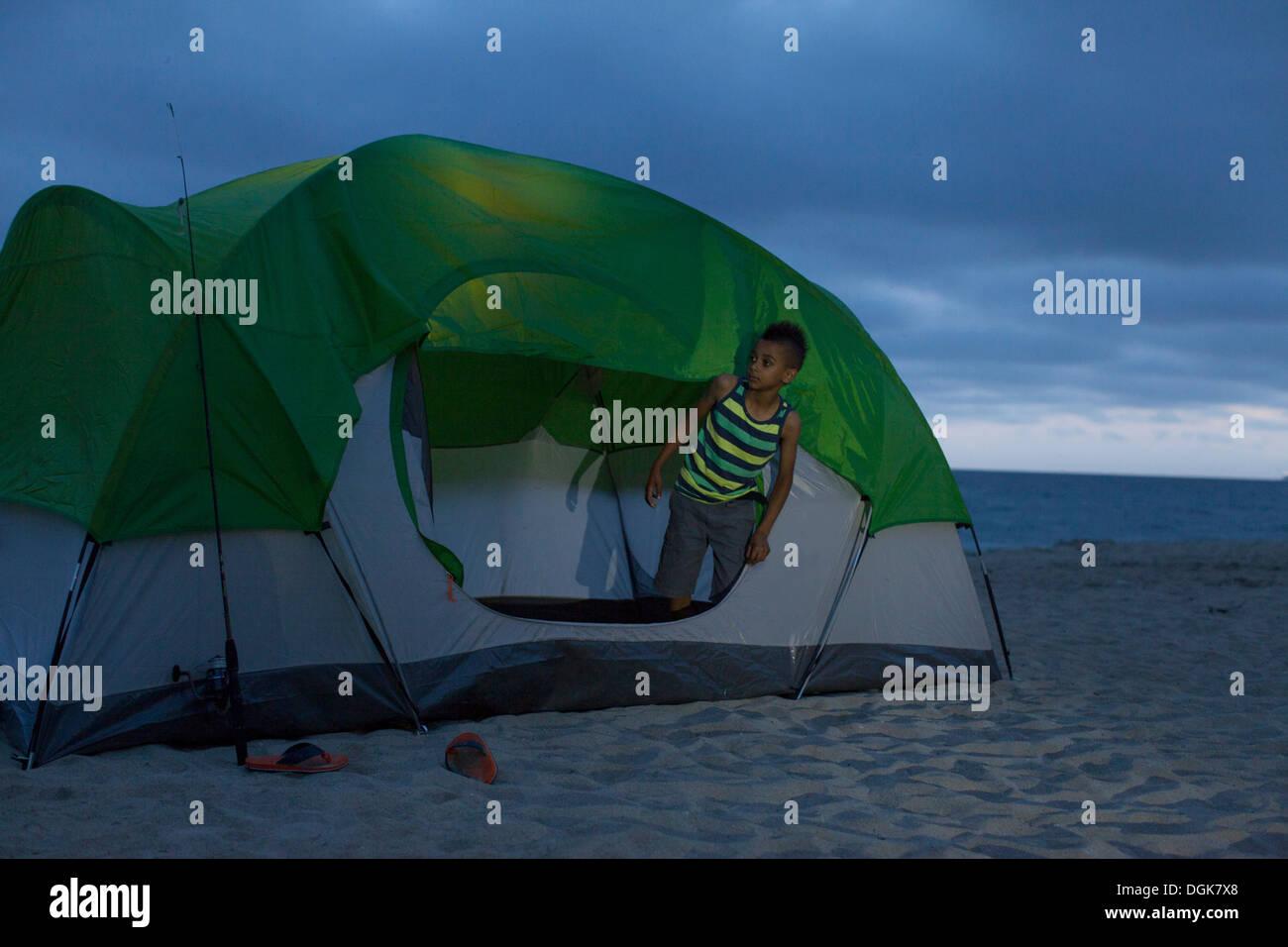 Boy in tent on Huntington Beach California USA & Boy in tent on Huntington Beach California USA Stock Photo ...