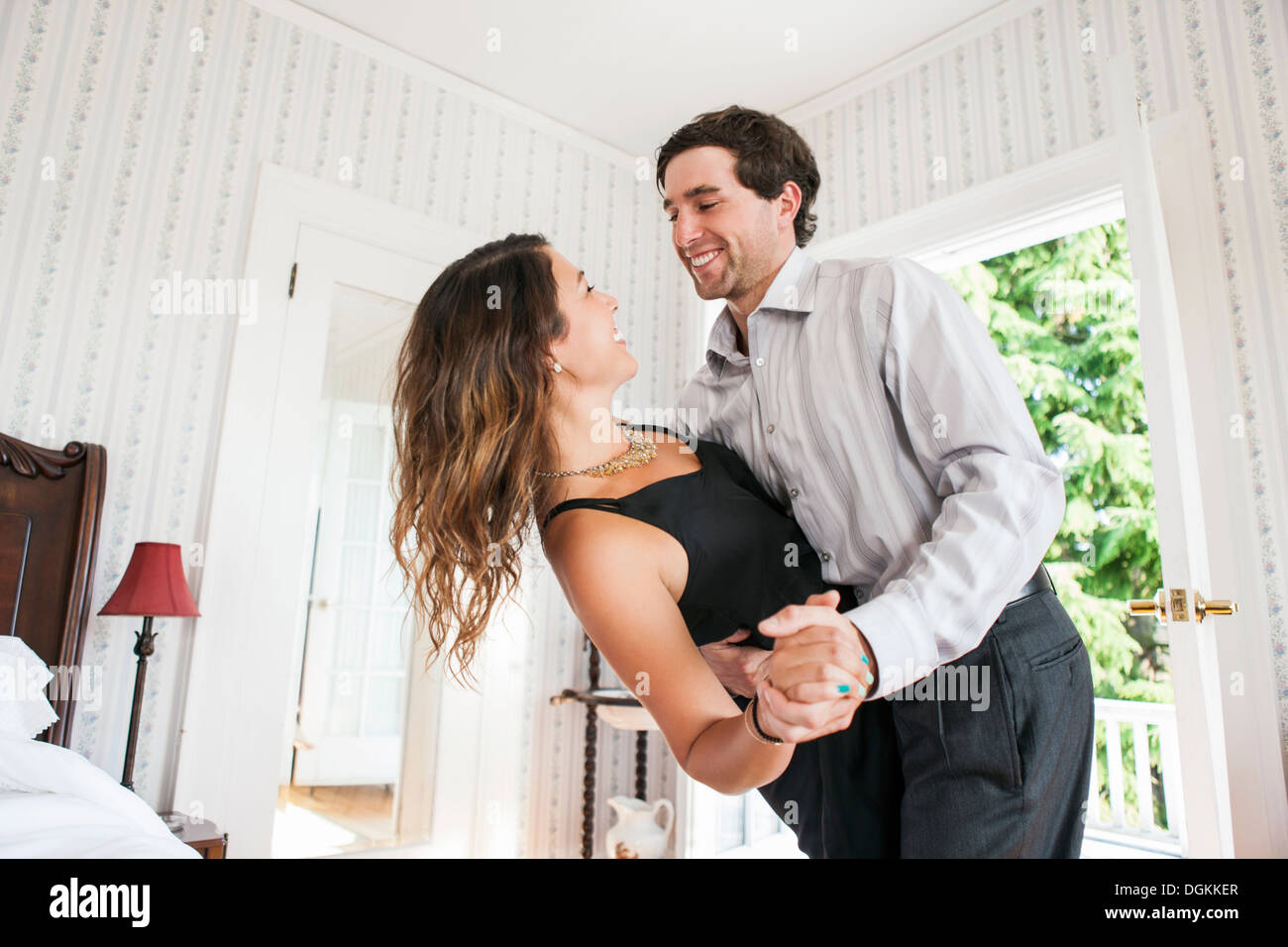 Stock Photo   Young couple dancing in bedroom. Young Couple Dancing In Bedroom Stock Photo  Royalty Free Image