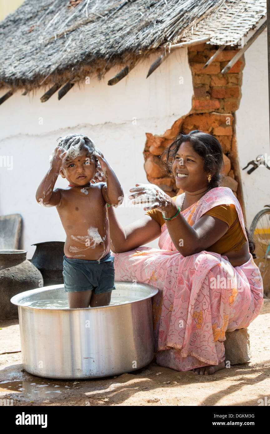Indian Mother washing her girl in a metal pot in a rural indian Stock Photo: 61898468 - Alamy