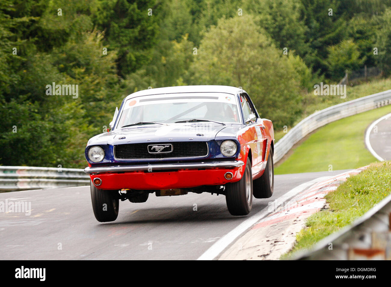ford mustang jumping at a jump hill ac cobra oldtimer grand prix stock photo royalty free. Black Bedroom Furniture Sets. Home Design Ideas