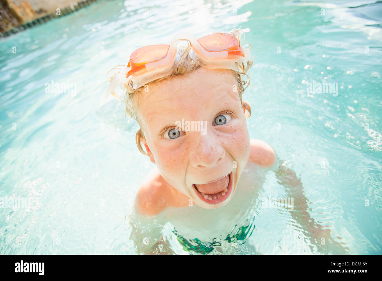 Boy 4 5 Swimming In Swimming Pool And Making Funny Face Stock Photo Royalty Free Image