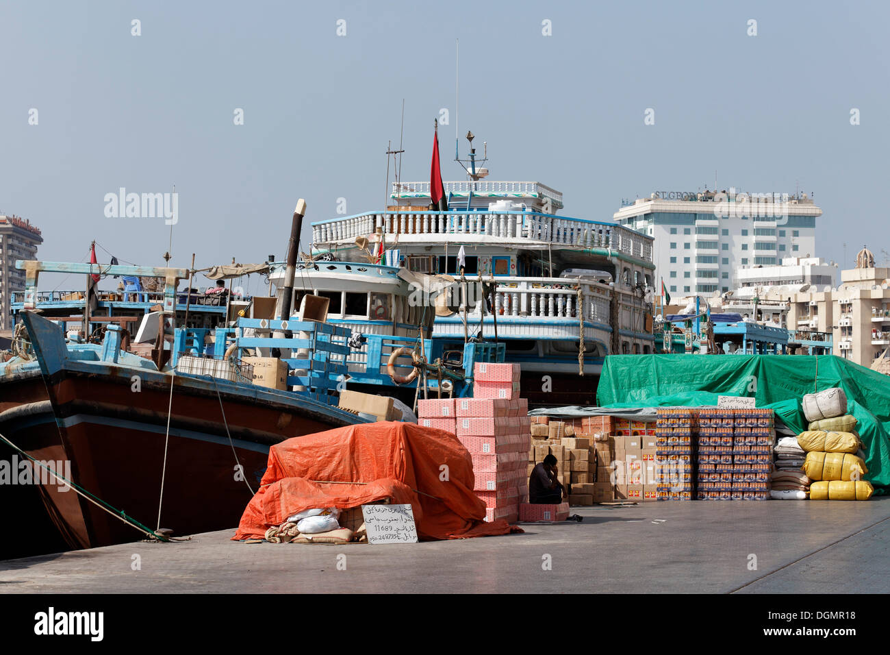 Cargo In Front Of An Old Wooden Ship Dhow Or Dau On Dubai Creek United Arab Emirates Middle East Asia