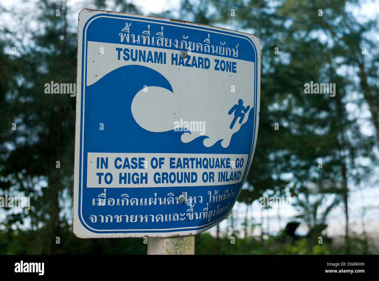 tsunami warning sign on the beach with direction to escape route khao lak phuket thailand asia