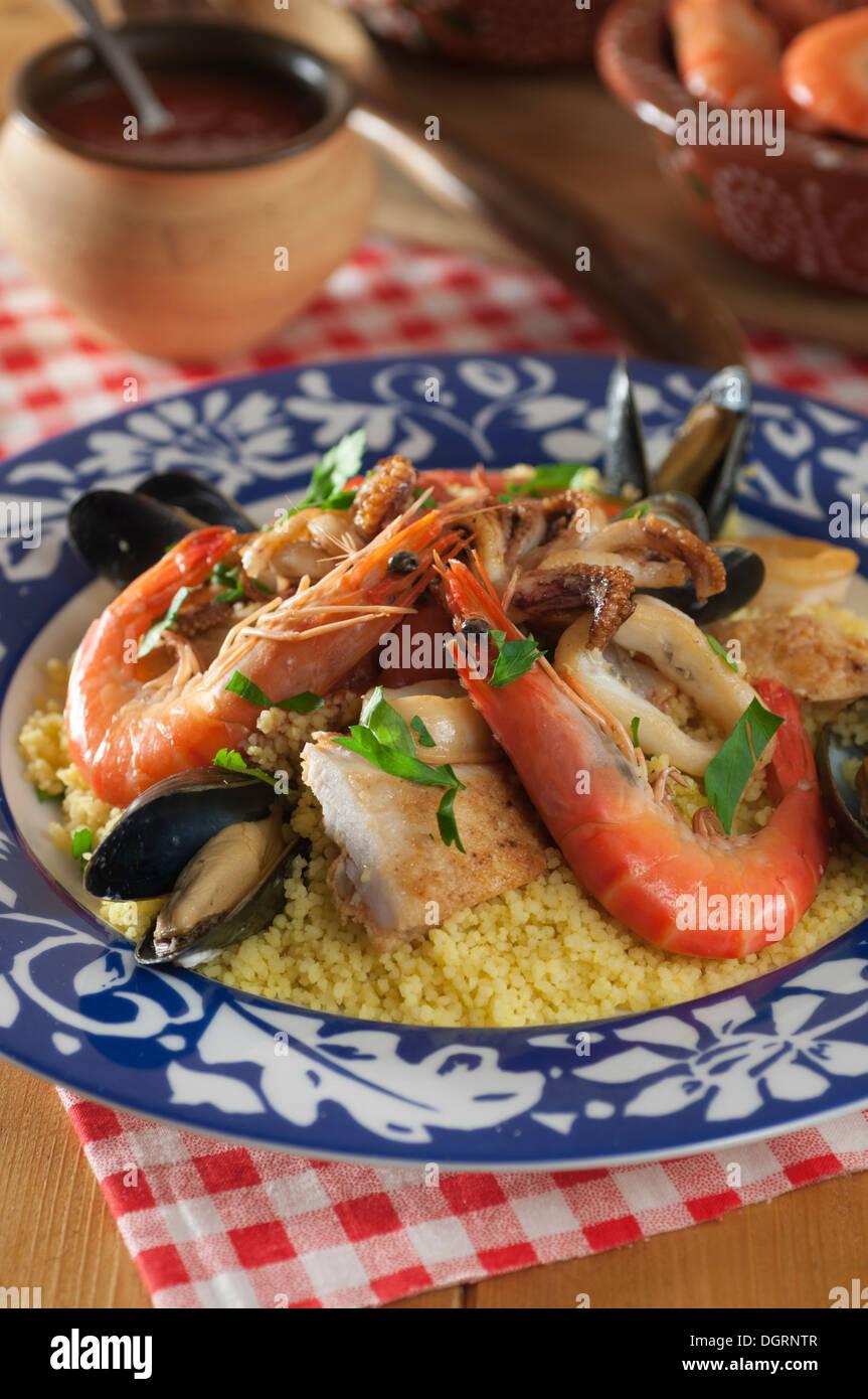 Couscous alla Trapanese. Sicilian seafood couscous Stock ...