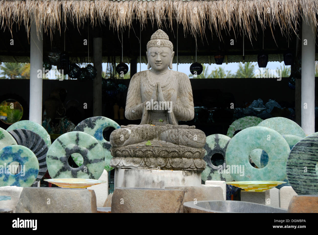 stone sculptures souvenirs buddha statue in meditation with blue stone rings on sale in