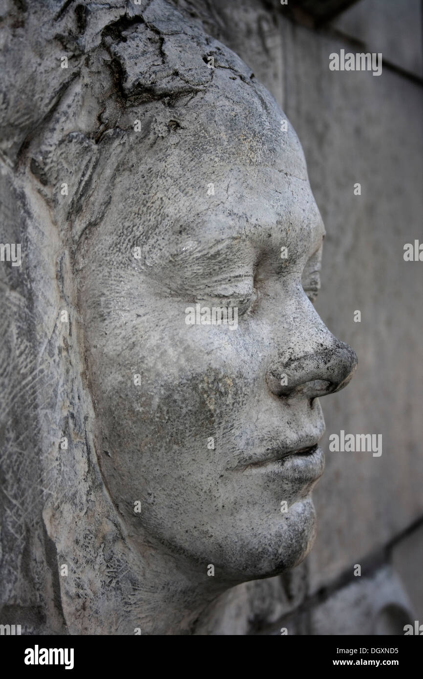 Stone carving art a woman s face stock photo