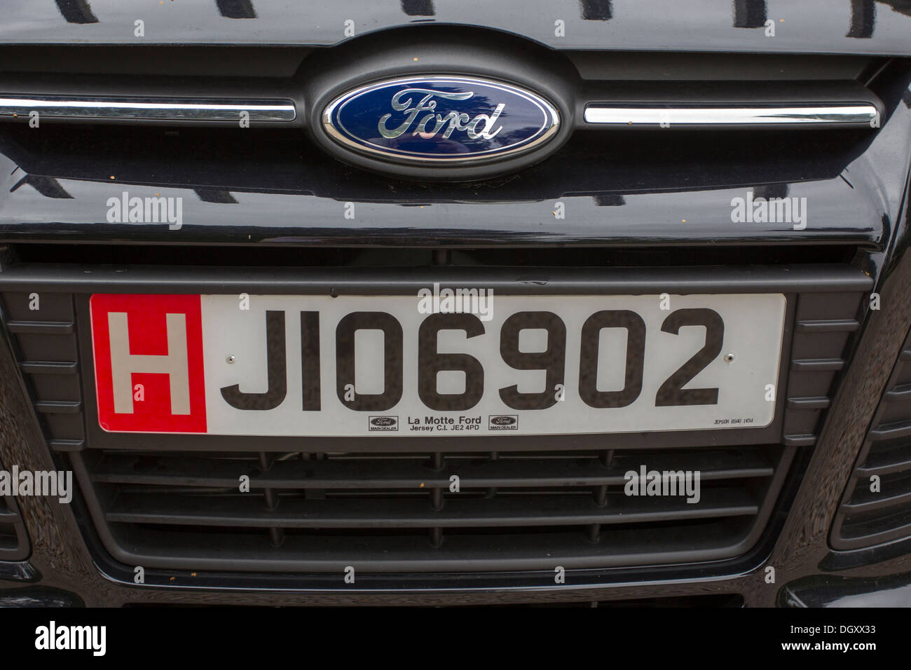 Jersey number plates for hire car red H tourist Stock Photo ...