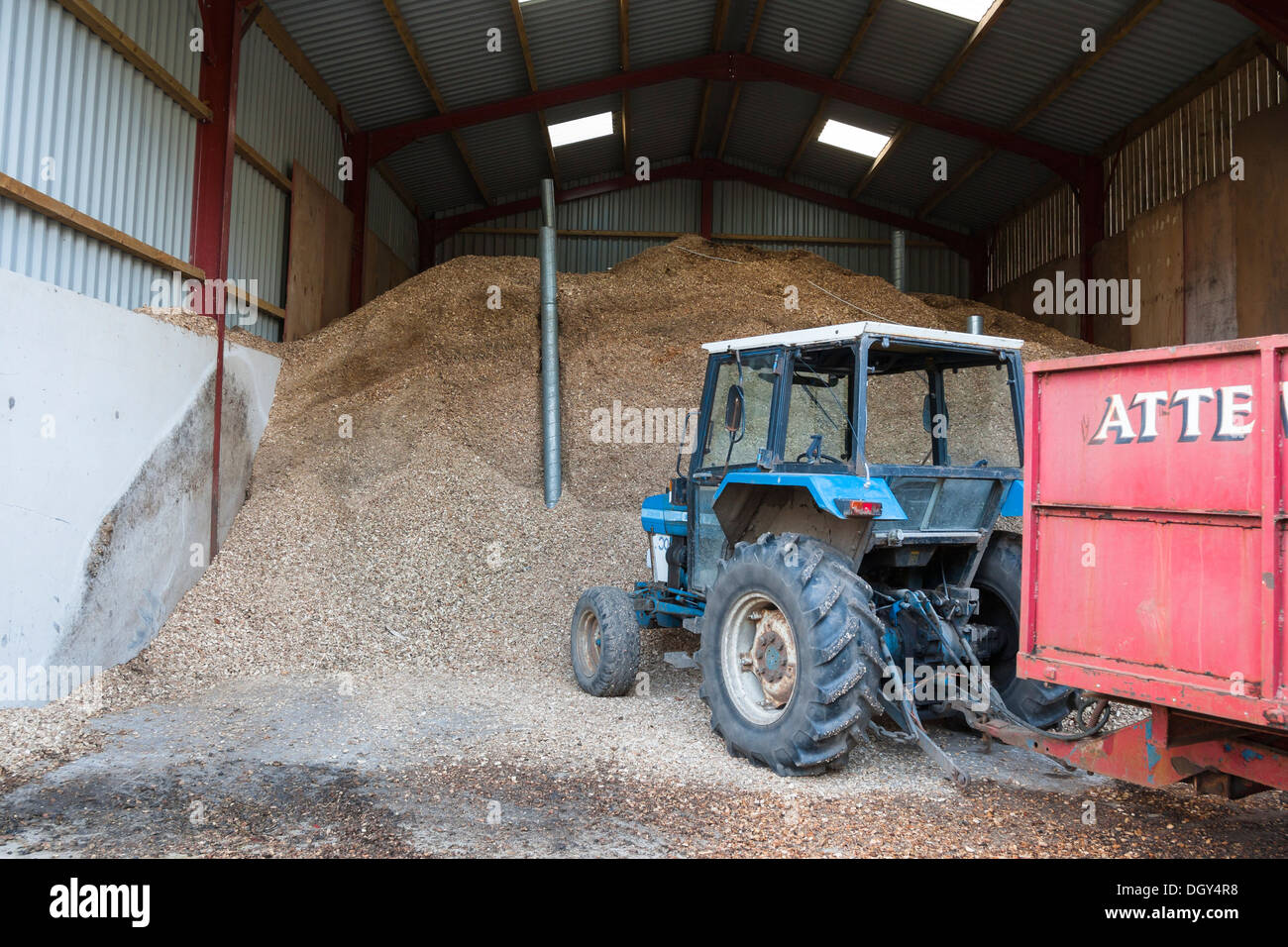 Biomass Storage Shed With Tractor And Trailer