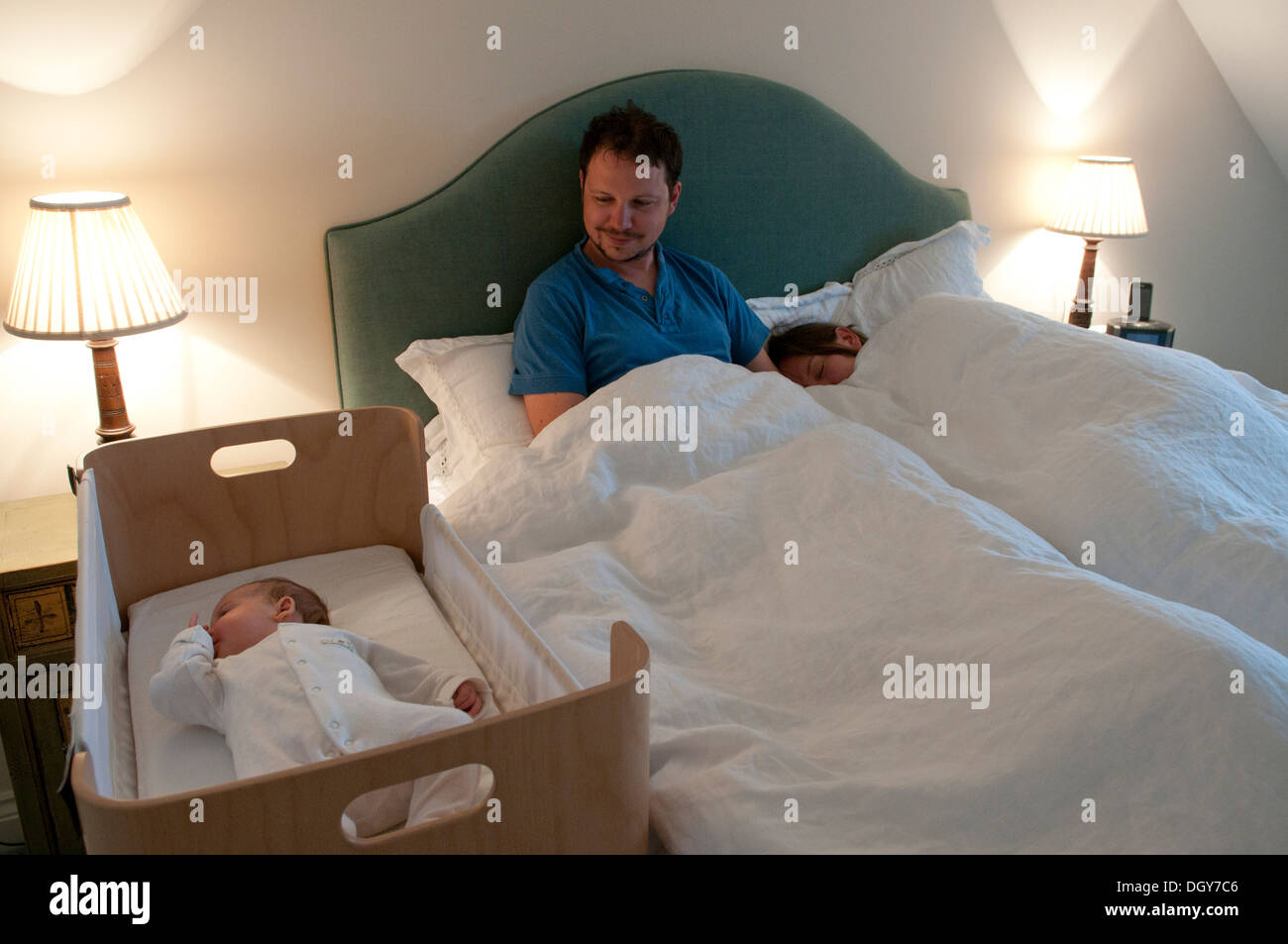 Baby bed in parents room - New Parents In Bed Mum Asleep Dad Awake Watching Their Baby Girl