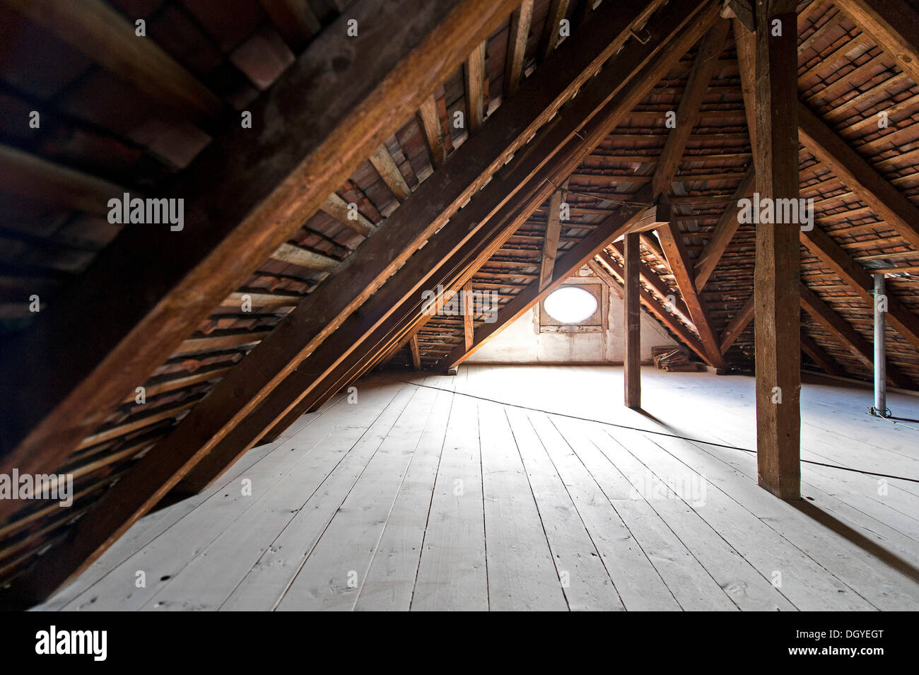 Wooden beams attic roof of an old building