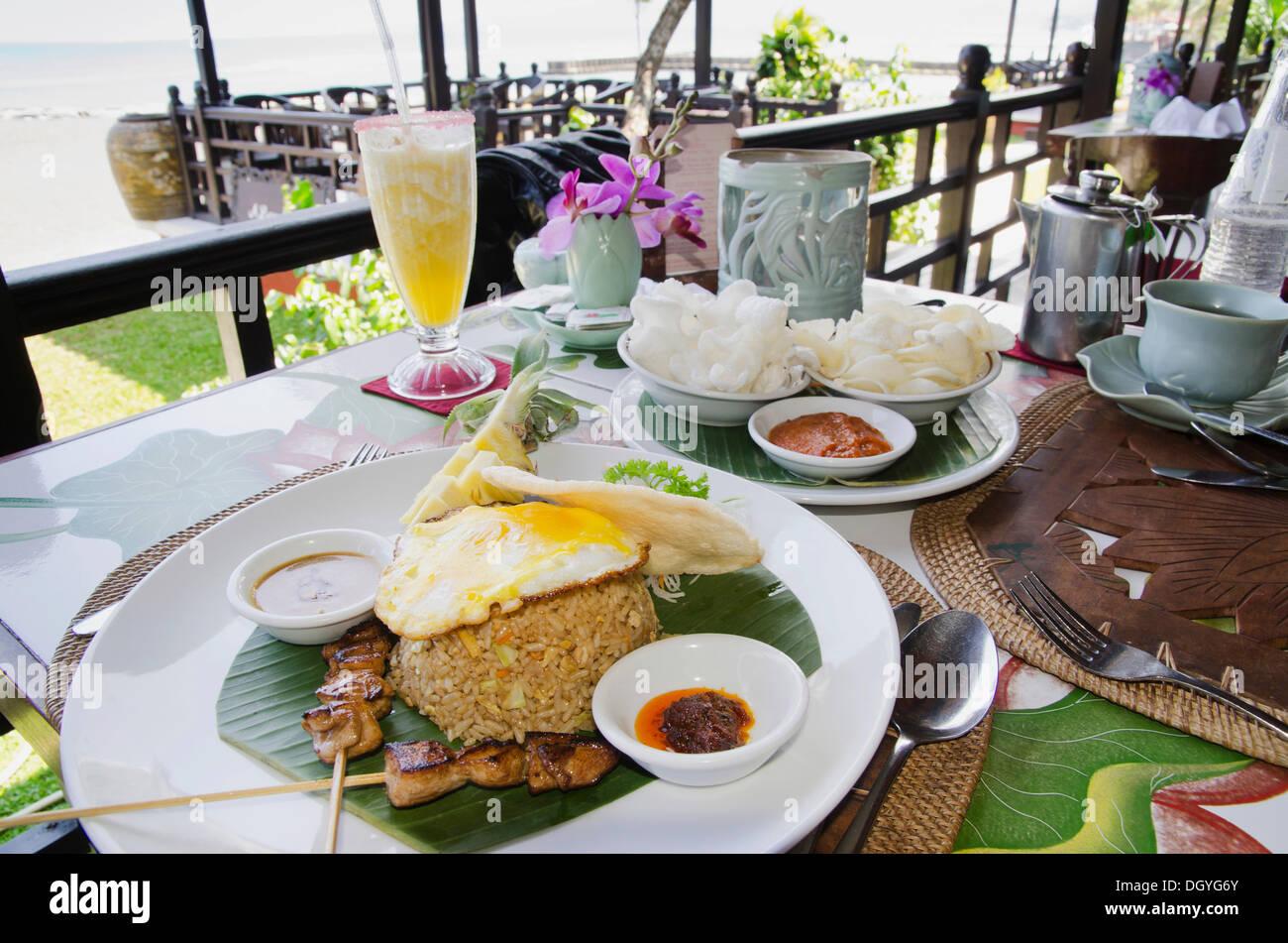 nasi goreng, indonesian fried rice, indonesian cuisine, at a stock