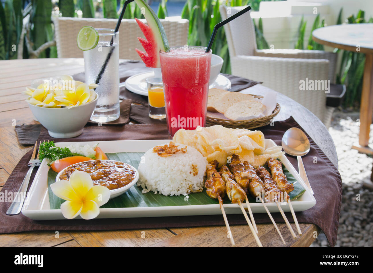 chicken satay, chicken skewers with rice, indonesian cuisine, at a