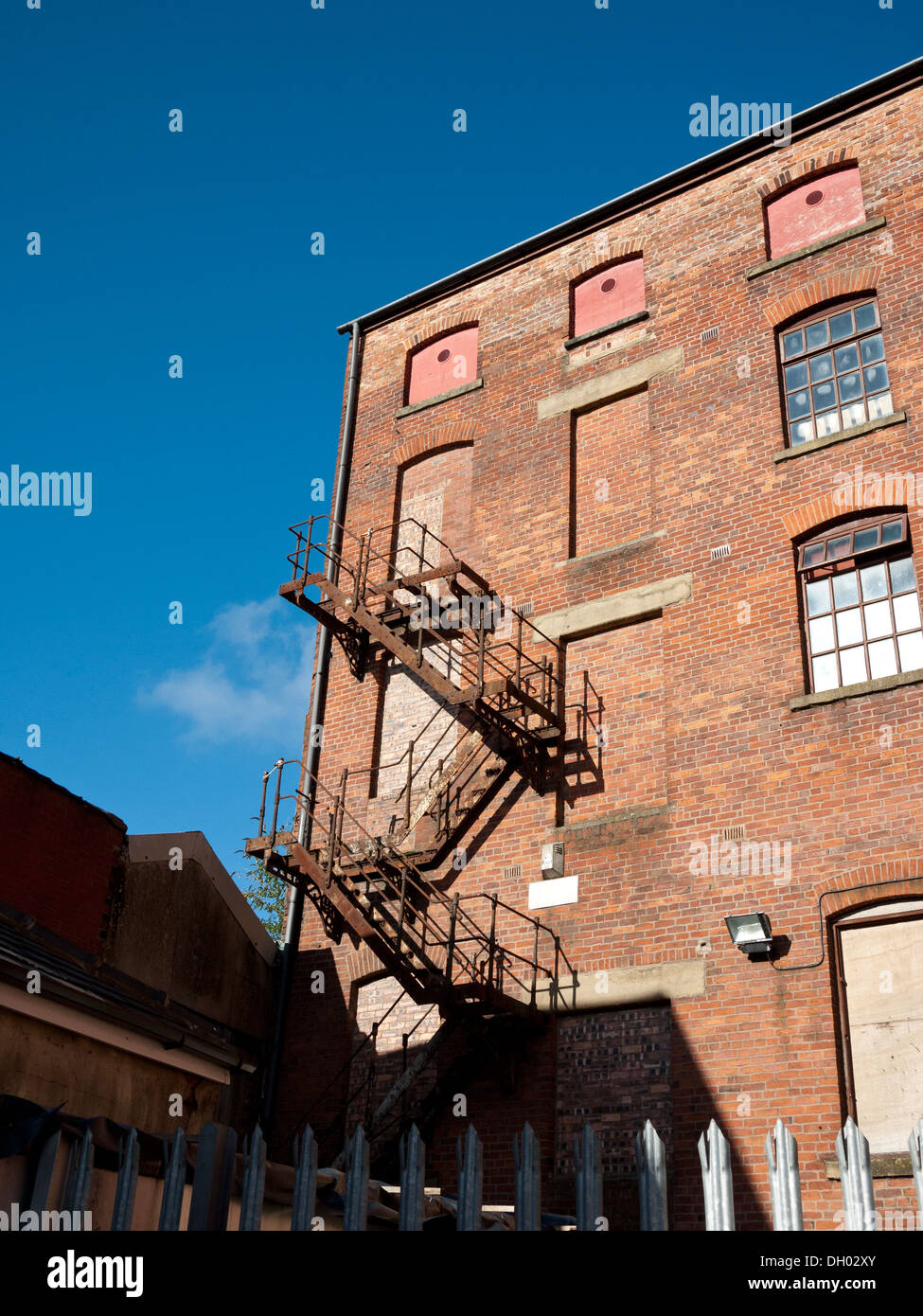 Fire escape from bricked up doorway to ground level on an old warehouse. Oldham Greater Manchester UK. & Fire escape from bricked up doorway to ground level on an old ... Pezcame.Com