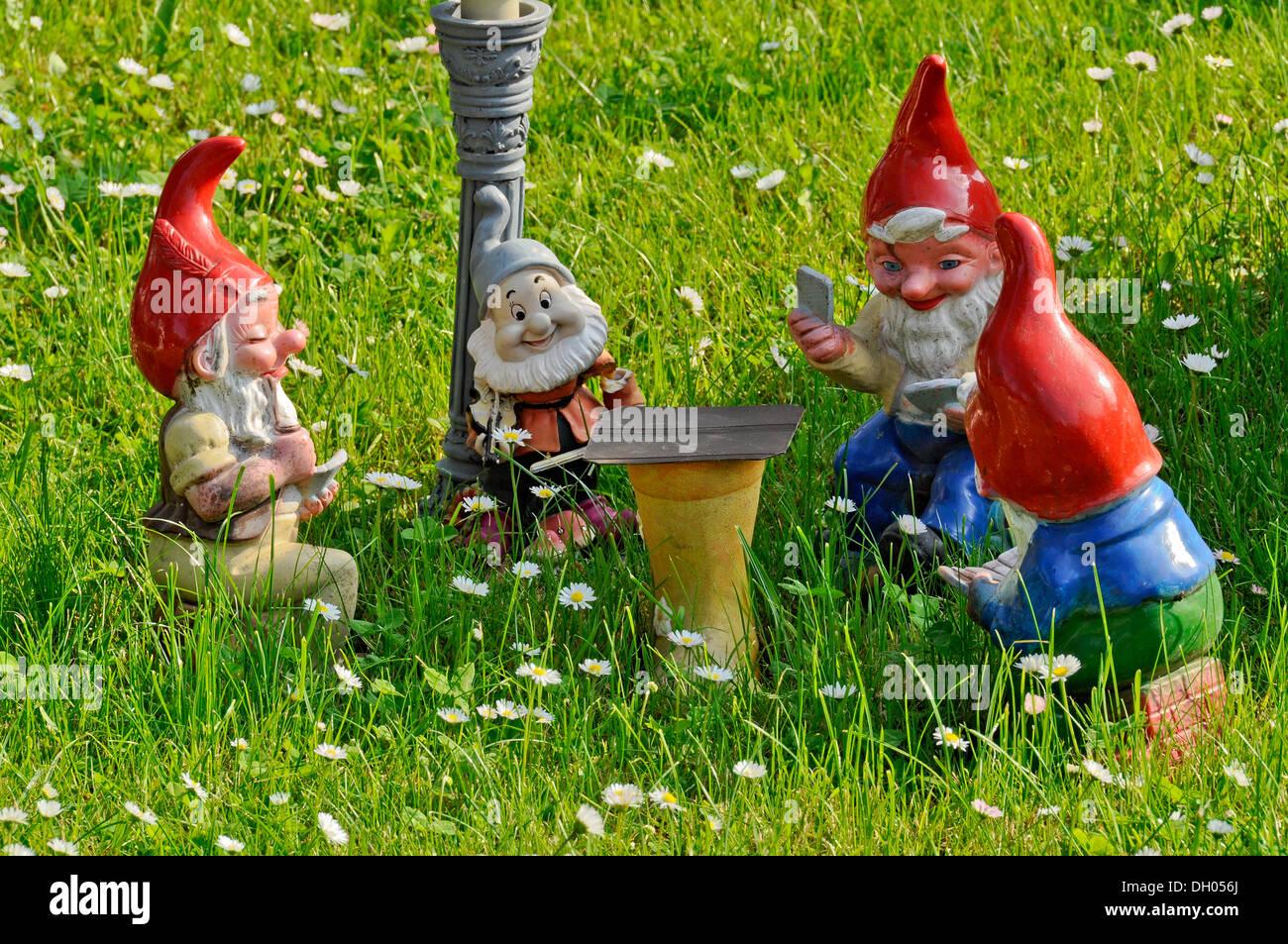 Garden Gnome In Garden Stock Photos & Garden Gnome In Garden Stock ...