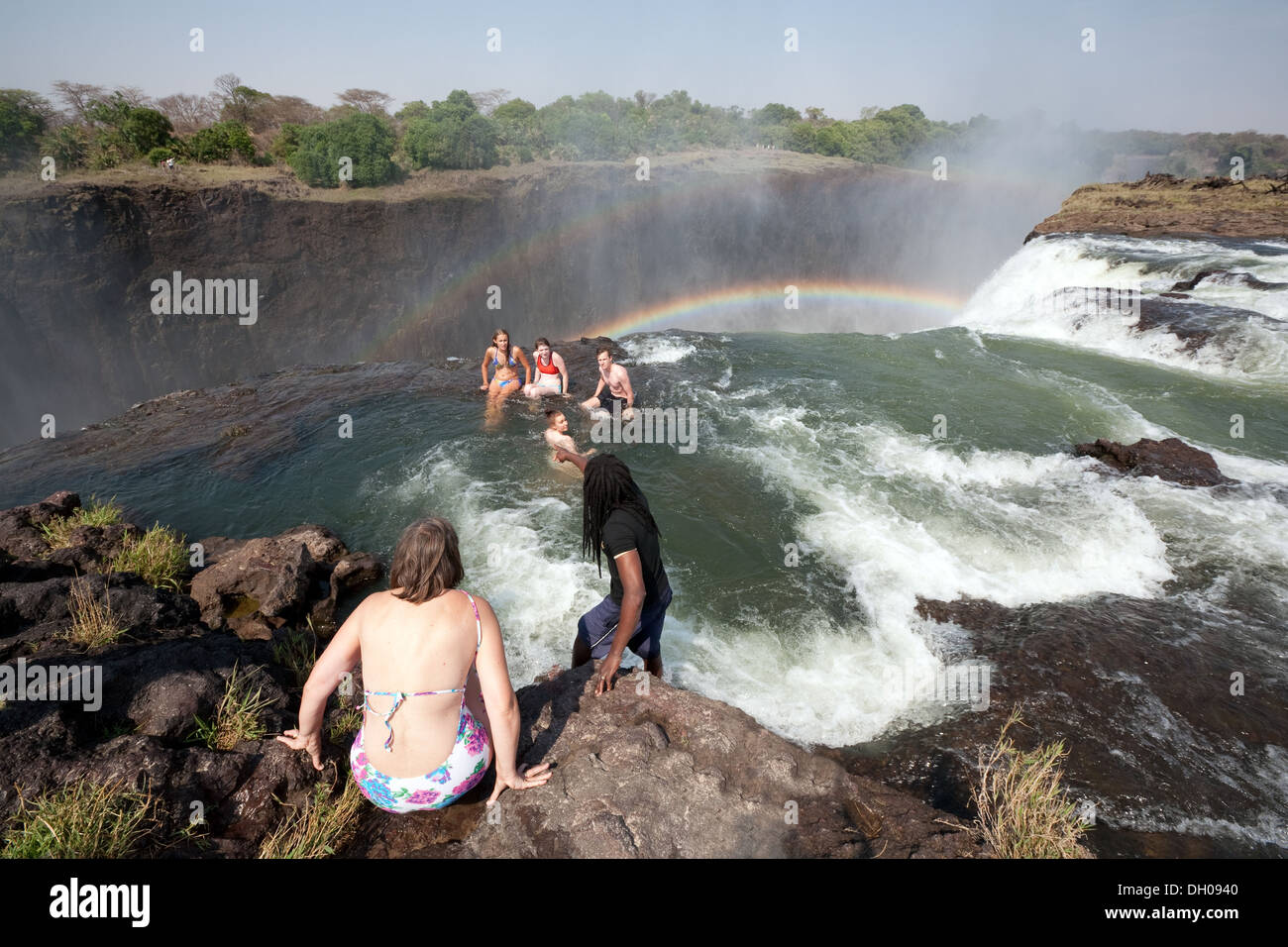 People Swimming In Devils Pool At The Edge Of The Victoria Falls Stock Photo Royalty Free Image