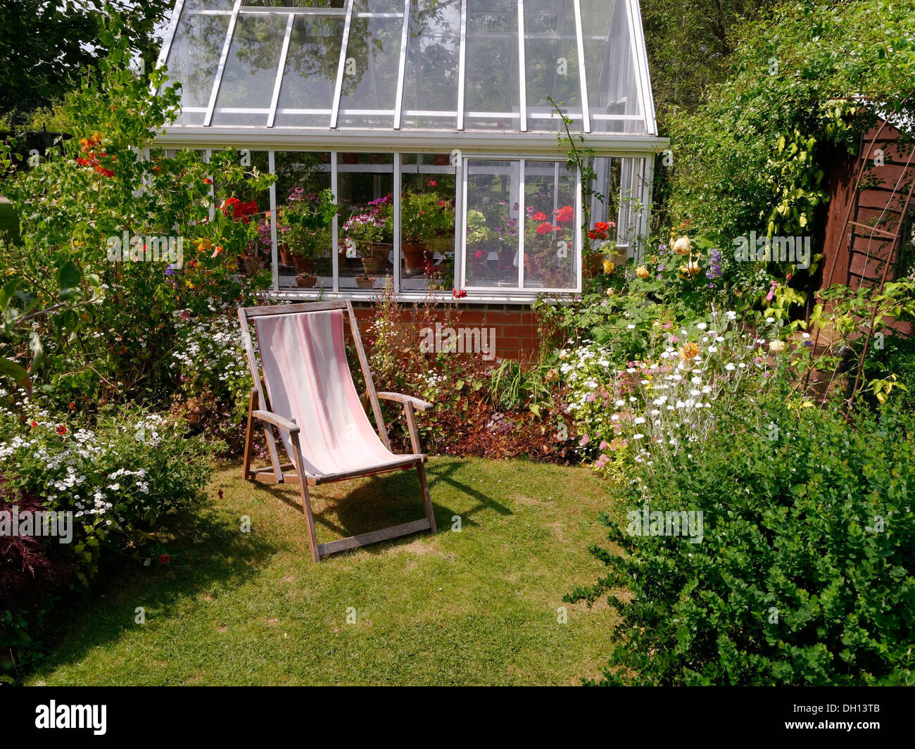 Small Lawned Garden With Borders Deck Chair And