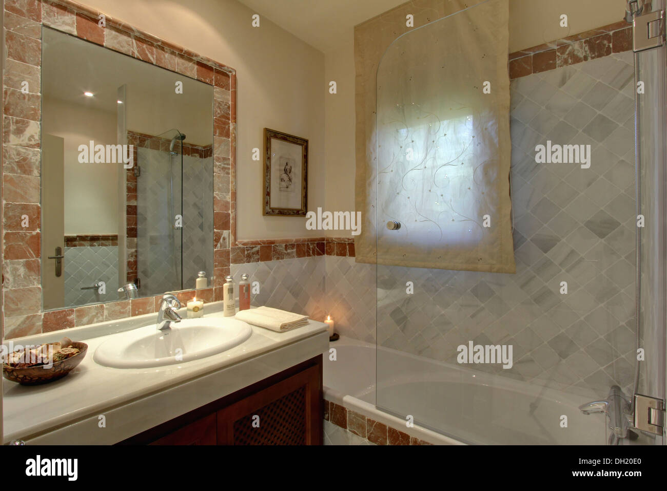 Bath Marble glass shower screen on bath in modern marble bathroom with voile