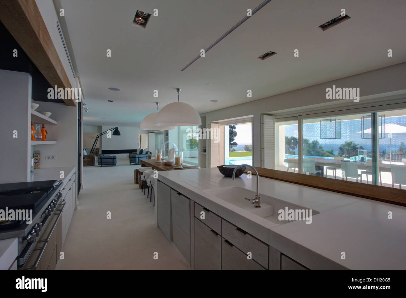 Sink And Chrome Tap In Fitted Unit Below Window In Large Galley Stock Photo Royalty Free Image