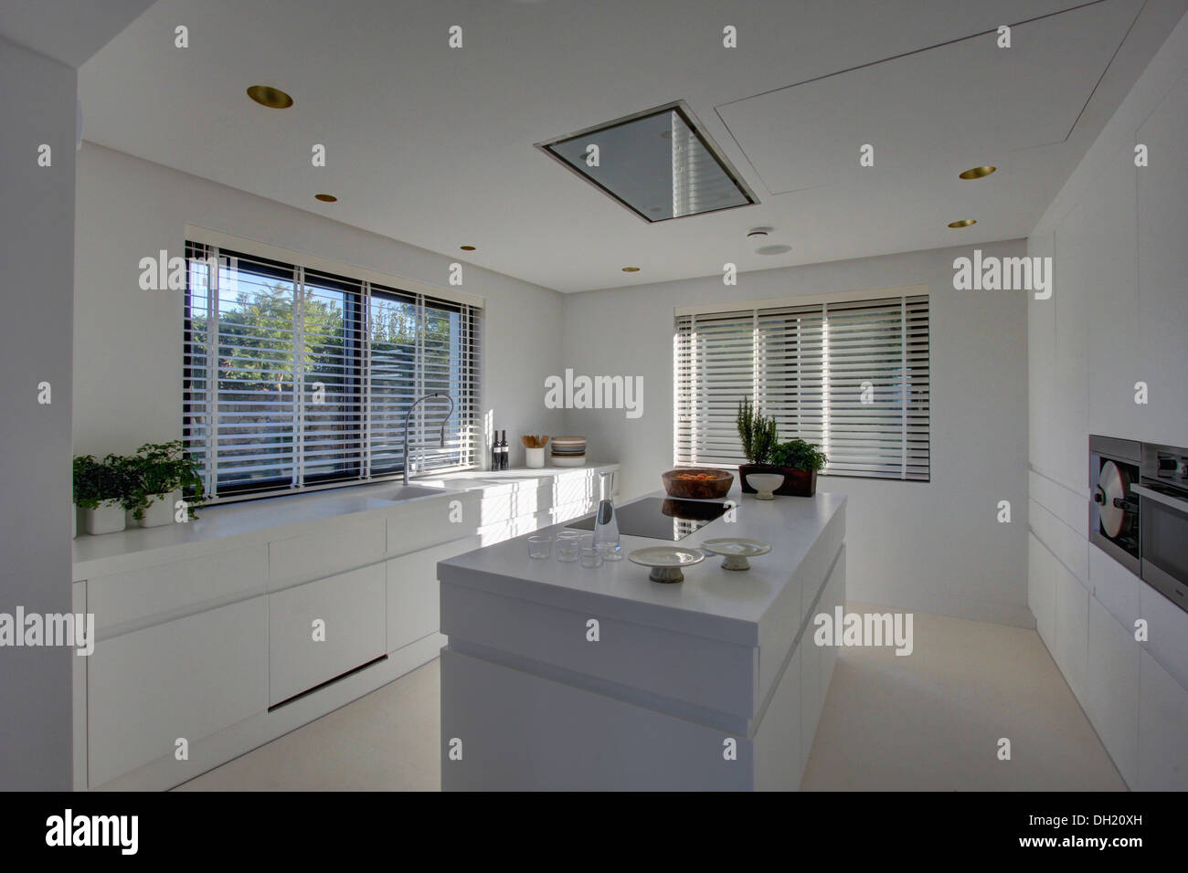 Modern Kitchen Blinds island unit in modern white kitchen with white venetian blinds on