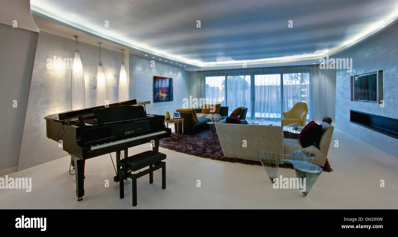 Grand Piano In Large Modern Apartment Living Room With Fluorescent Lighting On Recessed Ceiling And Oblong