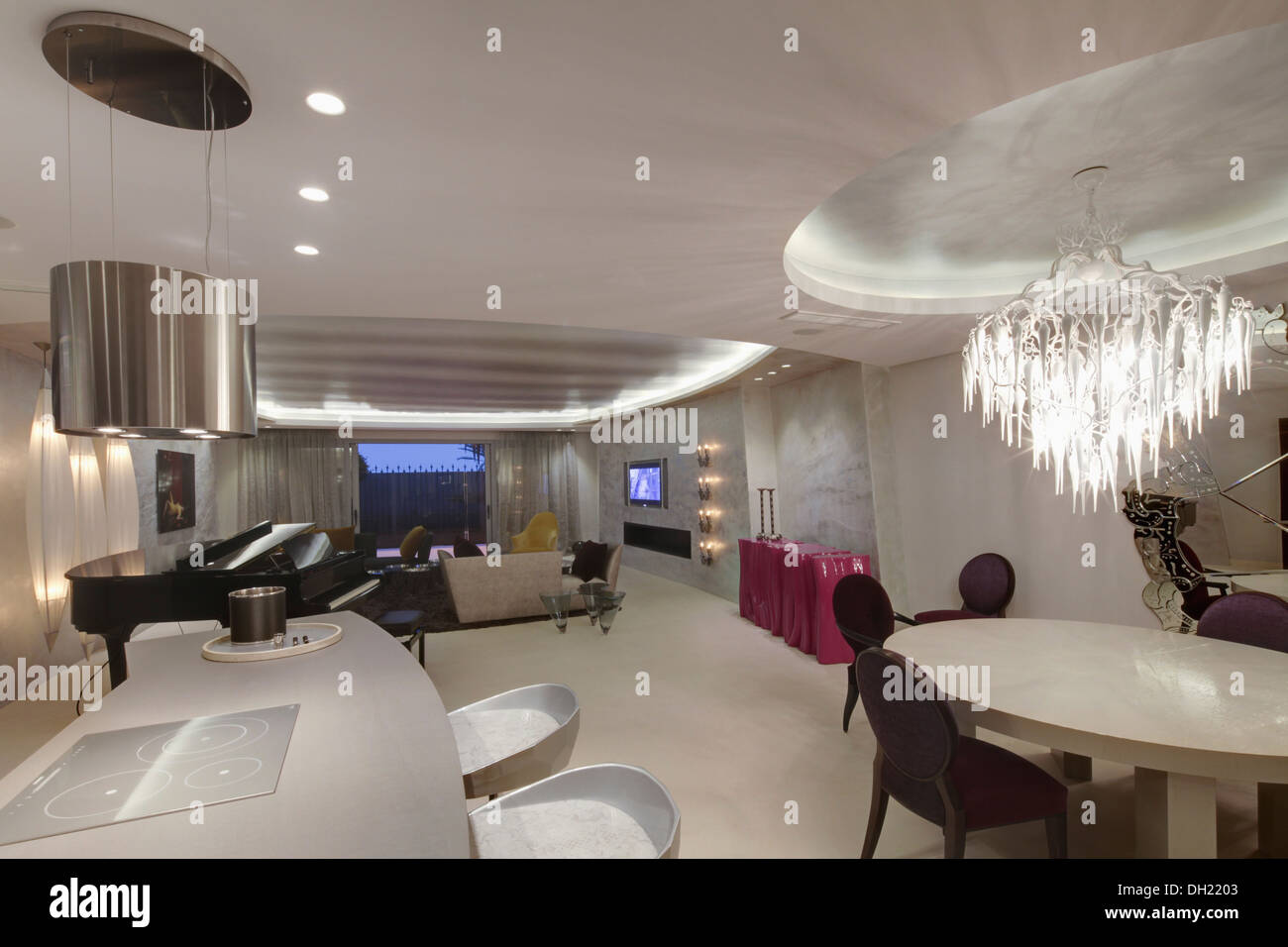 Chrome Light Above Breakfast Bar In Large Open Plan Living And Dining Room With Unusual Table