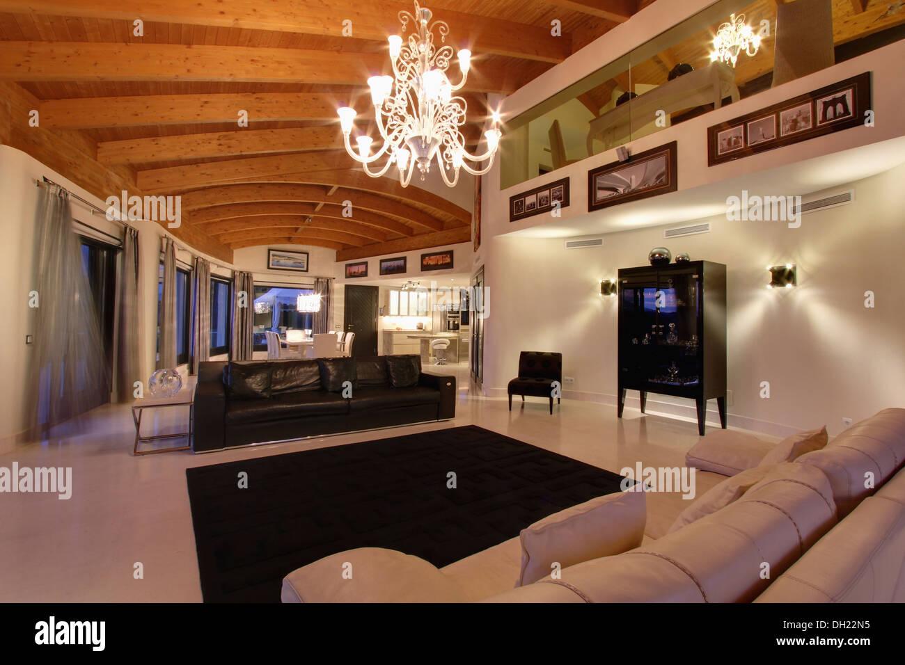 chandelier on beamed ceiling in large modern spanish living room spanish living room