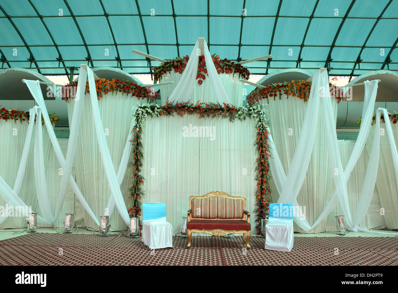 Empty chairs sofa indian wedding reception hall decoration for Photo decoration