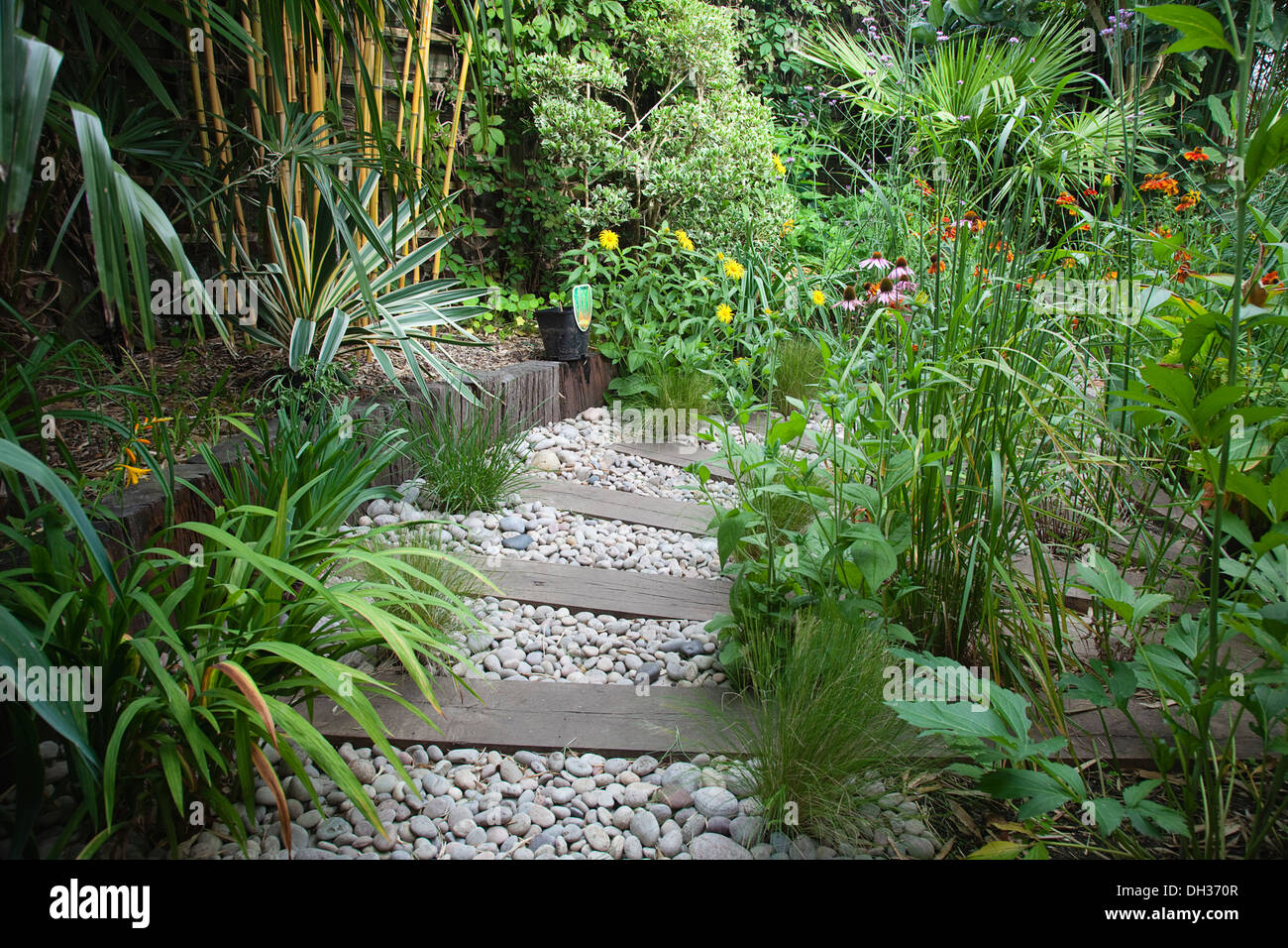 urban garden with pebble path and railway sleepers  planting includes stock photo  royalty free