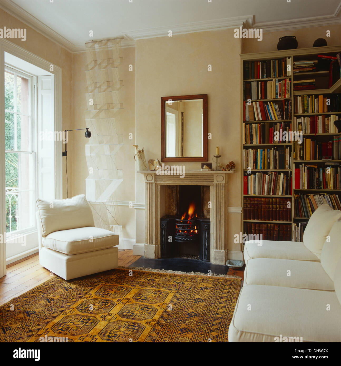 Stock Photo   White Chair And Sofa In White Living Room With Yellow  Patterned Oriental Rug In Front Of Georgian Fireplace With Lighted Fire