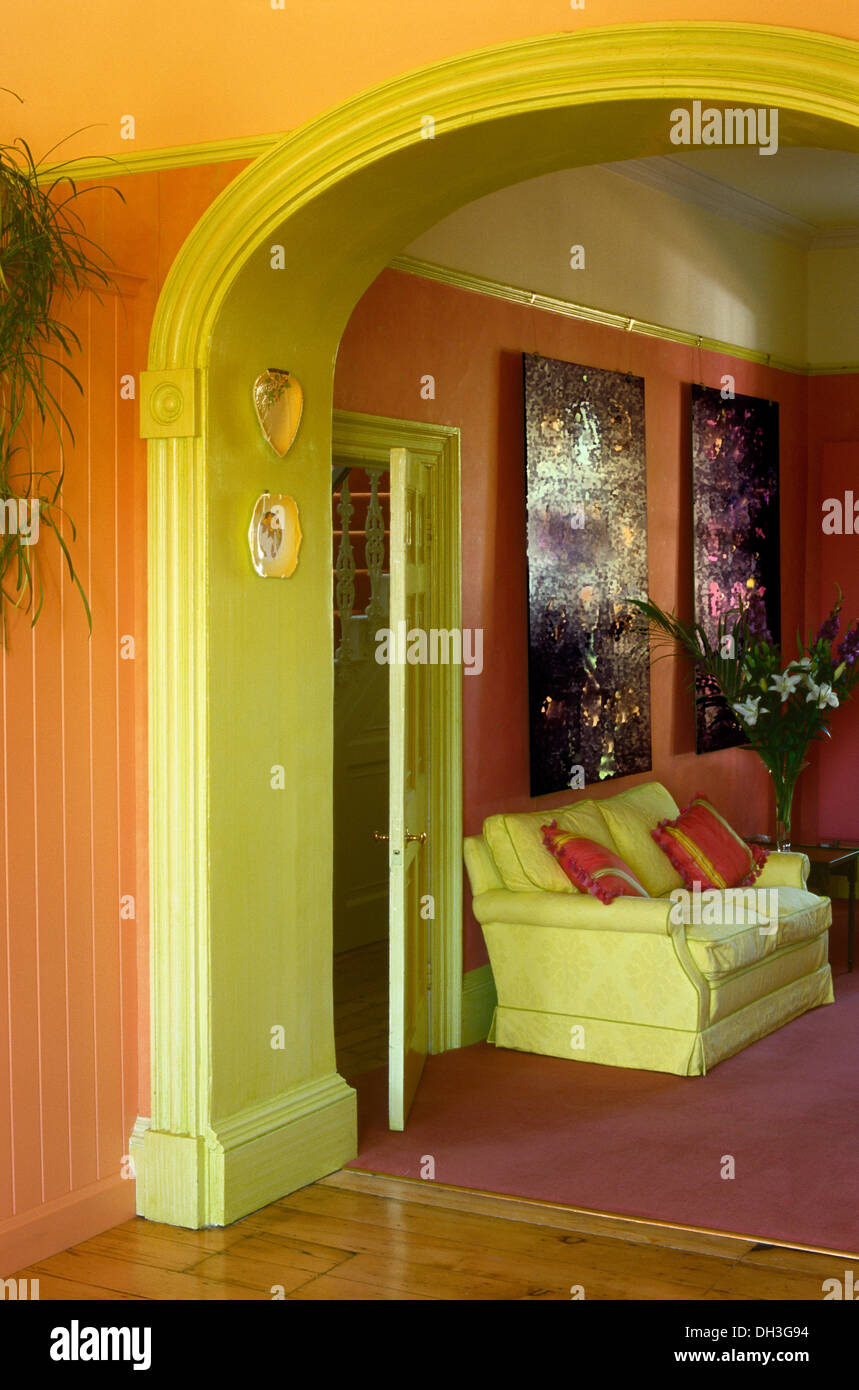 Orange Hall With Pale Green Painted Archway To Red Living Room With Stock Photo Royalty Free