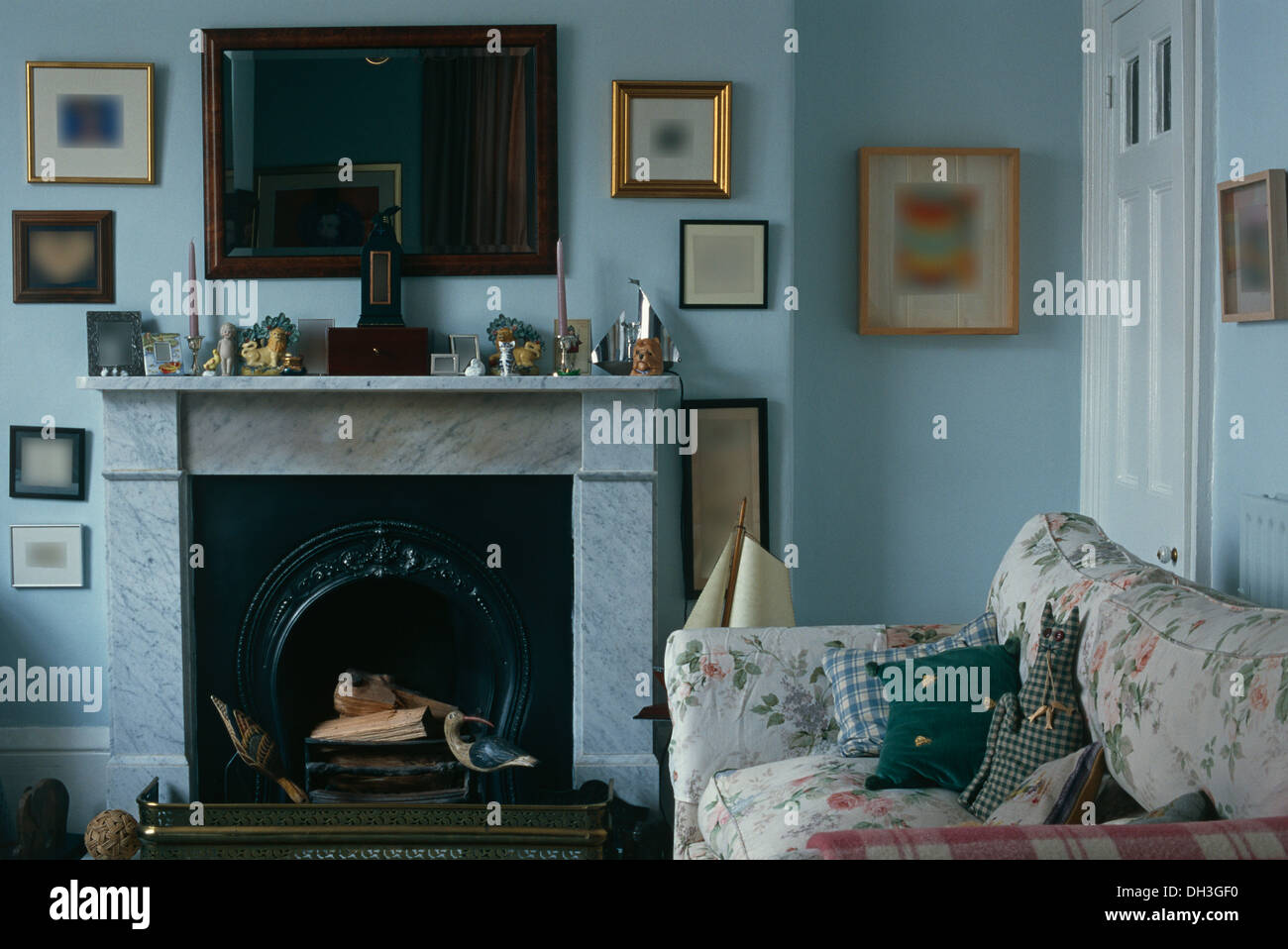 Mahogany Mirror Above Marble Fireplace In Pale Blue Country Living Room With Floral Sofa