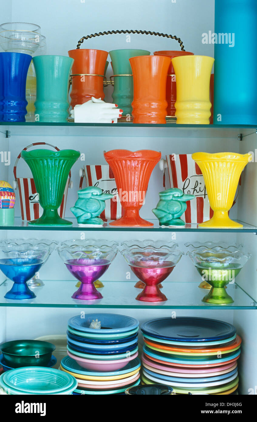 Collection of colorful glass vases and plates displayed on collection of colorful glass vases and plates displayed on recessed glass shelves reviewsmspy