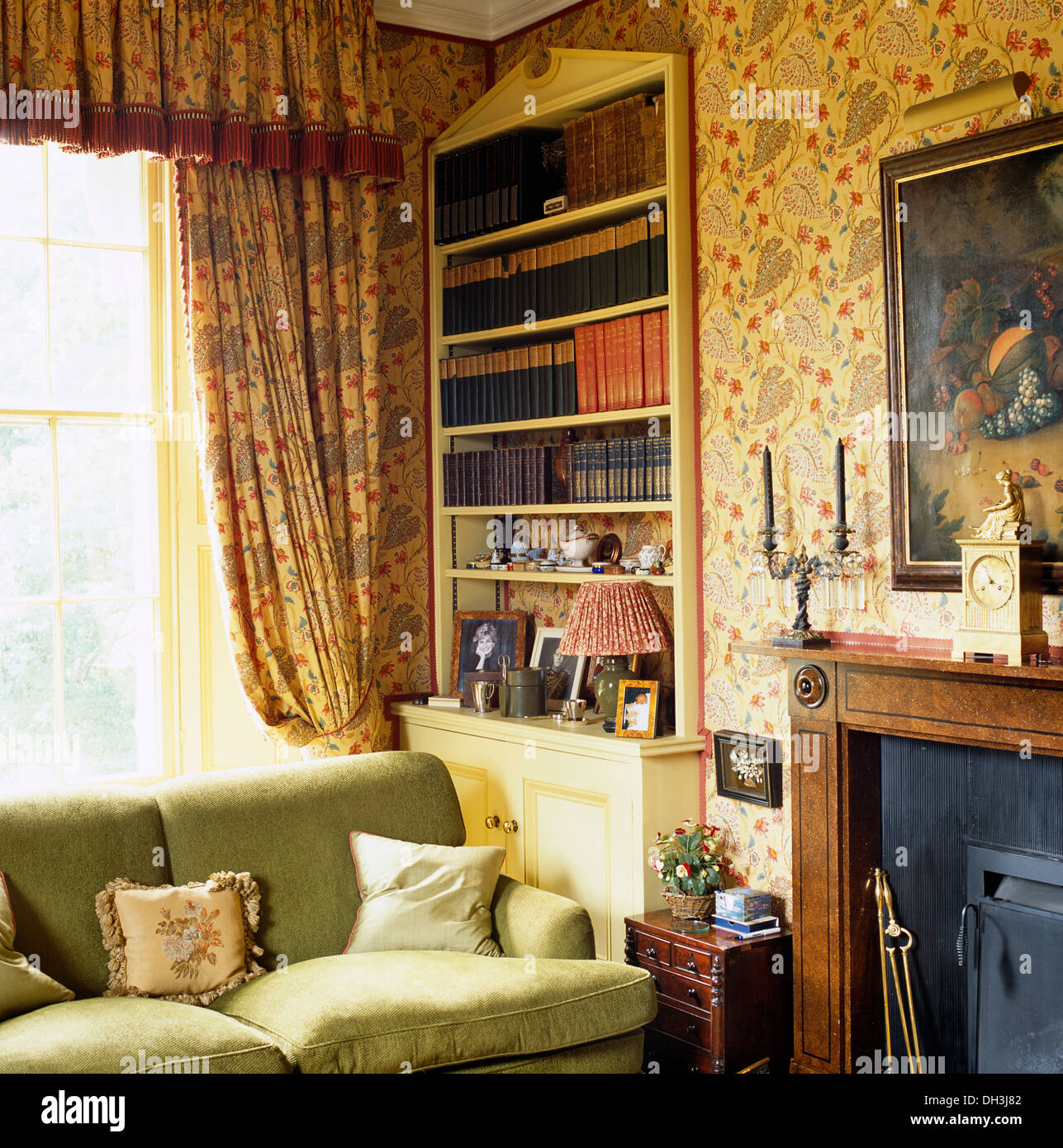Floral curtains and pedimented alcove bookcase behind sofa for Next living room wallpaper