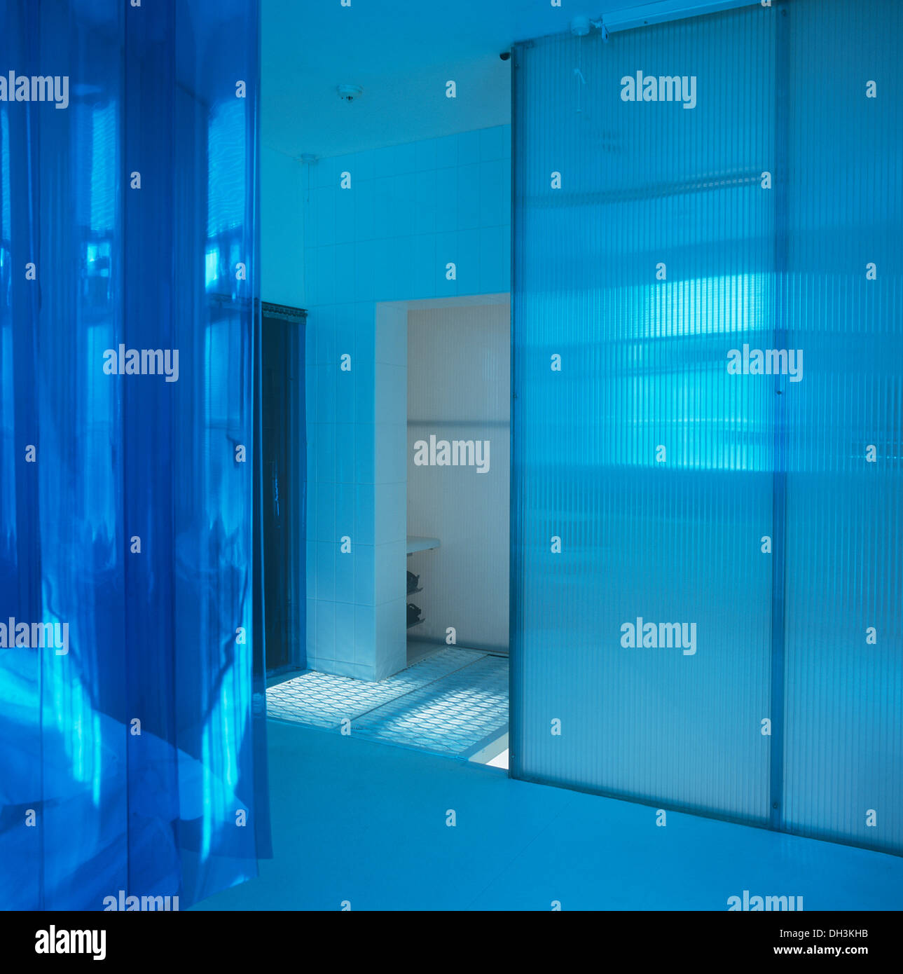 Bathroom plastic curtains - Blue Plastic Curtains On Bed In Modern Bedroom With Sliding Doors To Bathroom