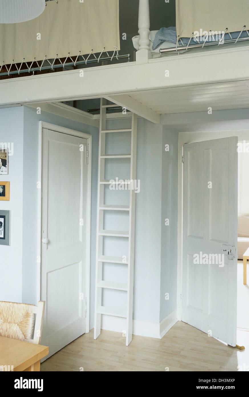 Studio apartment with ladder to bedroom on mezzanine floor for How to build a mezzanine floor for bedroom