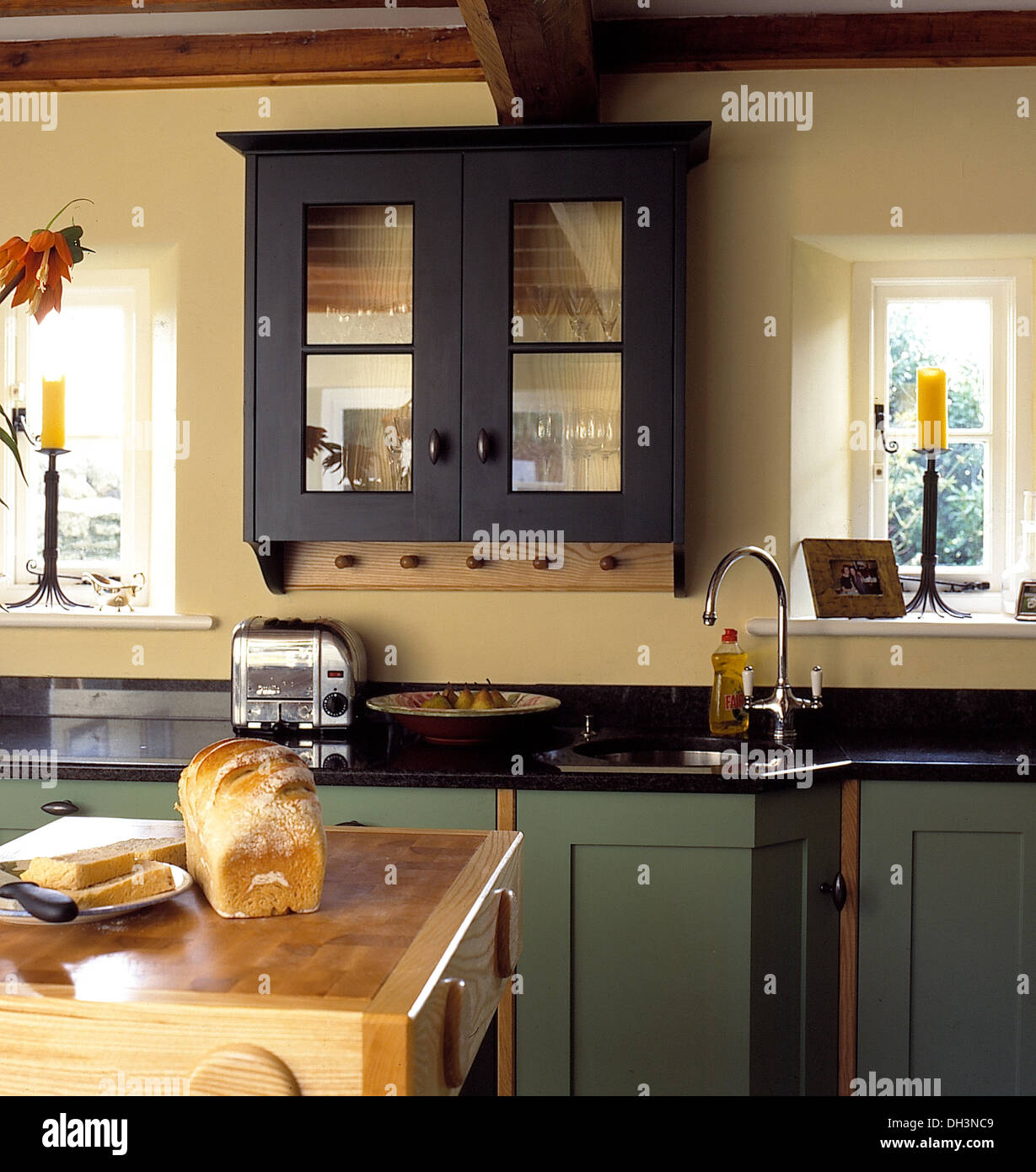 Kitchen Worktop Granite Glass Fronted Wall Cupboard Above Dualit Toaster On Black Granite