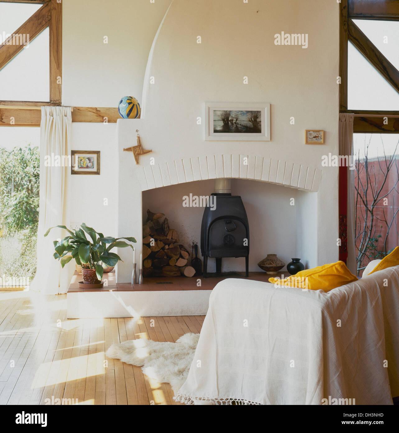 Modern Cottage Living Room White Throw On Sofa In Front Of Fireplace In Modern Cottage Living